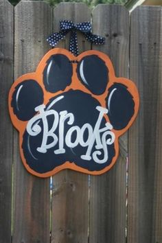 """There are so many choices for door hangers and outdoor team spirit signs, but these by Dondee Hicks at Artist Tree are so charming. """"Each door hanger is cut from premium quality wood, sande… Teacher Door Signs, Classroom Signs, Cnc, Cheer Camp, Tiger Paw, Locker Decorations, Burlap Door Hangers, Wooden Crafts, Burlap Crafts"""