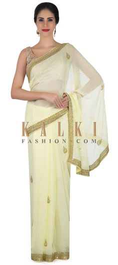 Lime yellow saree in georgette with sequin embroidery only on Kalki