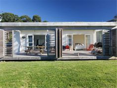 The Waiheke luxury holiday house & Beachfront& is a perfect family holiday home on Waiheke Island with stunning panoramic water views over Oneroa Bay. Waiheke Island, Beach Holiday, Family Holiday, Holiday Accommodation, Luxury Holidays, Logs, Beach House, Shed, Exterior