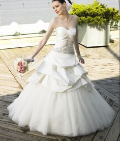 Elegant A-line Bridal Gown with Satin Overlaid Organza Train