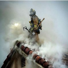 Firefighter on top of smoke filled home Wildland Firefighter, Firefighter Paramedic, Firefighter Love, Firefighter Quotes, Volunteer Firefighter, Firefighter Tattoos, Fire Dept, Fire Department, Firefighter Pictures