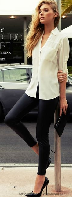 Simply classic. I ama sucker for the simple things!! Long hair, simple/laid-back make-up, loose fitting white top and sort of leather annkle-length pants paired with the PERFECT black heels - awesome ..j