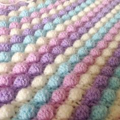 Today's #wip bobble blanket. Stylecraft special dk in clematis sherbet cream and wisteria as chosen by customer. #crochet #crochetblanket #bobbleblanket #craft #handmade #etsyshop #stylecraftspecialdk #babyblanket by skinnybeader