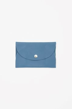 An envelope design, this purse is made from soft leather with a subtle textured finish. Unlined, it has a single compartment, raw-cut edges and closes with a metal press button.