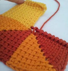 Even though this Ten Stitch Tunisian Crochet has all sorts of unique techniques going on, it's still an easy crochet blanket pattern. The triangles and squares have such a great geometric appeal. This crochet blanket pattern uses a ten-stitch method.