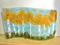 """Approx. size 8"""" x 13"""". Waved design stand alone. Fused art glass, home decor. Gorgeous with light in front or in back. When this one sells, I will make one especially for you. Some glass and colors ma"""