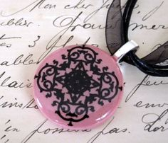 Pink and Black Scroll Necklace via Etsy -- inspiration