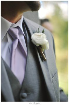 White boutonniere photographed by sMmPhotography.com
