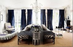 """Back-to-back sofas in a large room. Windsor Smith is a master of """"eclectic looks – part classic and part modern, dressy – yet casual at the same time.  Here she mixes velvet and silk with a linen slipped ottoman;  trendy zebra skins mix with traditional hand painted wallpaper."""" Joni Webb of Cote de Texas blog."""