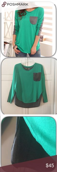 JUST IN! NWT Gorgeous Green & Gray Long Sleeve Tee I love this top! It is Green in the front and gray in the back! It is super soft and very comfortable! Wear with jeans for comfy casual look! It also is slightly longer in the back! Boutique Tops Tees - Long Sleeve