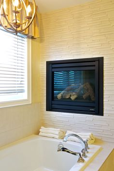 Wall mounted fire in the bathroom
