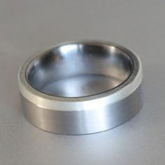 flat titanium ring with side silver inlay