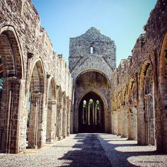 Medieval sunlit arches, Boyle Abbey, Co. Roscommon, Ireland