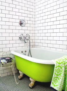 Bright Green bathtub and subway tile.  Bathroom love. (And I don't even take baths!)