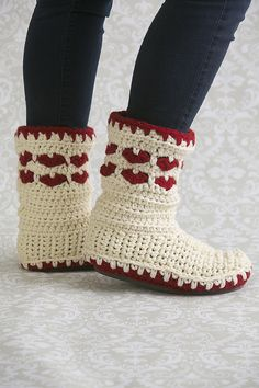 Forget about wearing your heart on your sleeve, wear it on your feet instead! This Valentine's Day, crochet your own cozy slippers to laze around the house in. Instructions are included to attach a rubber sole so your slippers have some extra stability. Crochet Boots, Crochet Slippers, Cute Crochet, Crochet Crafts, Crochet Clothes, Crochet Projects, Crochet Baby, Knit Crochet, Holiday Crochet
