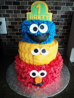 """Sesame Street Cake--love the """"fuzzy"""" look of the buttercream icing--this would be cute with the star picks shooting out everywhere, too!--would put Elmo on top layer and Cookie Monster on bottom with cookies around the bottom and one in his mouth"""