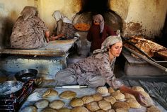 Photo by @stevemccurryofficial // After the death of their husbands these Kabul widows established a bakery to generate income. As can be seen from the piles of traditional Afghan flat breads and small loaves it is a successful business.  What is most striking however are the women's hands. Hands can often be equal to the face in expressiveness. Strong from kneading dough all day the hands of these woman are strong yet elegant. by natgeo
