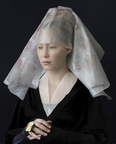 Updating the Dutch/Flemish portrait with modern disposables. Look closely at the ring and headdress.