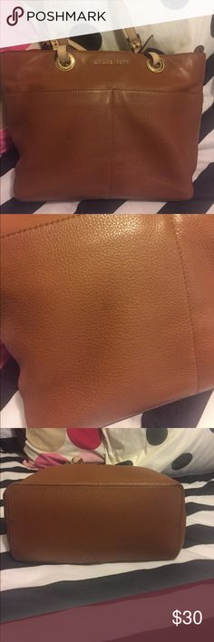 Michael Kors tote Soft brown leather with beige handles and gold accents. Couple of spots but not real noticeable and spotting from makeup and stuff on inside. Handles are in excellent condition Michael Kors Bags Totes