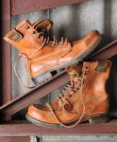 Superdry retro vintage Girder boots with scratch distressed detailing, leather laces with eyelet and hooks, embossed logo detailing and ankle logo patch. $179.95