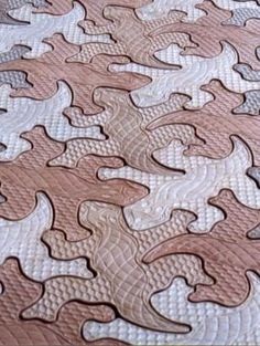 """""""Escher up the walls and outside""""  Wonderful designs based on Escher's art. I love these lizard-shaped pavers you make with a mold."""