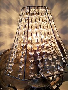 Crystal lamp shade….take fabric off old lampshade and string crystals onto the old lampshade frame. Did it- awesome