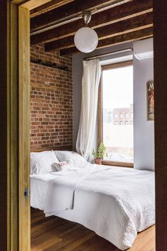 In Brooklyn, an 1890s Townhouse Is Reborn With Tons of Light and a Crisp Black Facade #redhook #brooklyn #townhouse #renovation #bedroom