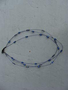 Ketting met blauwe kralen