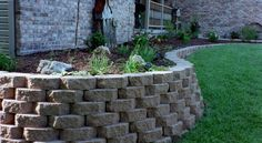 A garden bed retaining wall - when installed correctly, these structures can last indefinitely and provide added beauty (and stability) to beds. Garden Beds, Stability, Sidewalk, Canning, Landscape, Wall, Projects, Beauty, Courtyards