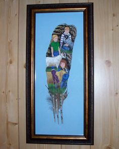 """hand painted 3, 13"""" feathers in a frame."""