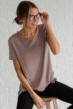 Bella Ella Boutique's Cross My Line Navy Striped Top is the perfect everyday tee! Our top features a rounded shaped neckline, short sleeves, and white and navy blue colored stripes.The Cross My Line Navy Striped Top would pair perfectly with our Killer Queen White Distressed Skinny Jeans or our Black Biker Chick Moto Jeggings.  #womensclothing #shoppingaddict #cute #retail #instasale #trend #trendy #trendymom #trendygirl #stripedshirt #classiclook