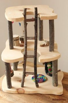 This Wooden Tree House is made with clean dry branches and smoothly sanded pine . This Wooden Tree House is made with clean dry branches and smoothly sanded pine boards. A lovely op Wooden Projects, Wood Crafts, Art Projects, Toy House, Gnome House, Wood Animals, Wooden Tree House, Best Doll House, Fairy Tree Houses