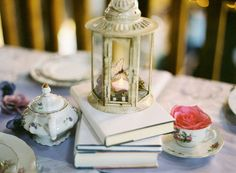 Romantic tea party decor - vintage lantern, books and china | photo by diana marie photography