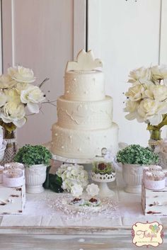 Gorgeous dove cake at a baptism party! See more party planning ideas at CatchMyParty.com!