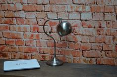 Office Desk Distressed Silver Lamp    This industrial look distressed silver lamp looks great on any desk in any office with adjustable beam/head, it's a high quality, very sturdy and solid lamp.        Details:      E27 screw fitting  easy to reach on/off switch  adjustable head  Only comes with UK plug          Delivery    We are only able to offer free postage to mainland England, Wales and Scotland. For all other locations please email us at enquiries@easterninspired.com so we can…