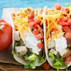 This recipe forchickenranch tacosis grilled chicken with bacon, homemade ranch sauce, cheese & fresh vegetables, all stuffed inside warm flour tortillas.