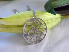 Floral Circle Pendant in stainless steel, silver flower necklace, toile necklace, nature jewelry, si Leaf Pendant, Stainless Steel Jewelry, Silver Flowers, Flower Necklace, Jewelry Collection, Floral, Clean Design, Metal Forming, Nature