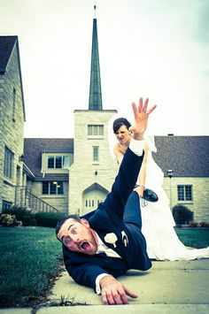 So funny, photo of the bride dragging her groom into the church!