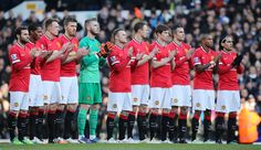 Manchester United during a minutes applause before the game for former Tottenham player Ron Henry