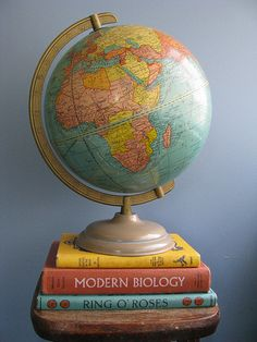 Globes a pinterest collection by jackie hagan globes map globe globevintage stacked books and world globe gumiabroncs Gallery