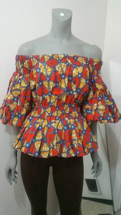 A sexy off-shoulder blouse with dramatic sleeves that gives you a stylish look.Elastic back and waiat to give you a wiggle room and hugs your body at the same time to show off those beautiful curves. Very chic can be rocked with jeans or leggings. African Fashion Designers, Latest African Fashion Dresses, African Print Fashion, Africa Fashion, Ankara Fashion, African Prints, African Fabric, African Attire, African Wear