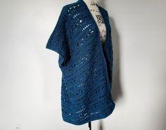 Water's edge kimono in Caron yarn in the color ocean. kimono on mannequin