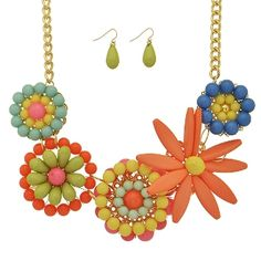 20 inch gold tone necklace, featuring a multicolored beaded floral focal. Comes with matching 1 inch fishhook earrings in green!   Shop online at www.coralandolive.com! Free shipping every day!  FB: www.facebook.com/coralandolive Instagram: @coralandolive
