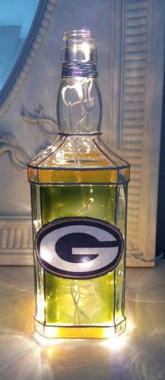 Hey, I found this really awesome Etsy listing at http://www.etsy.com/listing/150475226/green-bay-packers-bottle-light