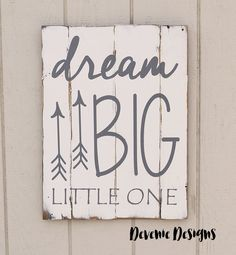 dream Big little one - reclaimed wood sign   dream BIG little one rustic reclaimed wood sign is hand painted in gray on a weathered white wood canvas. This sign can be customized to any color variations. The hand drawn arrows add a tribal/ woodland touch, the perfect sign for a bedroom or nursery. PLEASE NOTE: All items will be made when you order, you will receive a similar version of the picture above. Because of the nature of using reclaimed wood, hand painting, and distressing, you are…