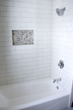 Tiled Shower: Angora Soho, 4x16, Biscuit; Grout: Mapei, Biscuit; Niche: Zen Fiji Cream Pebbles