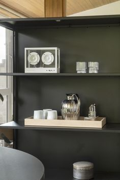 AD Bernadotte collection by Georg Jensen - Hege in France AD Bernadotte coffee and tea set on a black shelving unit. Minimal Scandinavian living room with Bernadotte pieces from Georg Jensen. #georgjensen #copenhagen #scandinaivanliving #nordicliving #coffeejug
