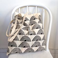 This listing is for one lightweight tote bag made of 100% unbleached cotton, hand printed with the Rows of Rainbows pattern in black ink. The bag is