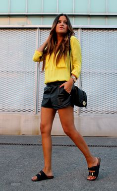 Streetstyle: yellow blouse + leather shorts + ugly sandals