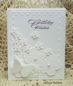 Embossing folder and punches. Looks hard but so easy!! This would also make a great wedding card.